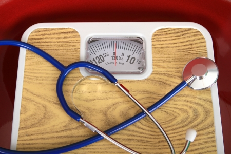 weight control: stethoscope and balance symbol photo for weight control