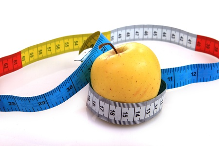 yellow apple and measure tape