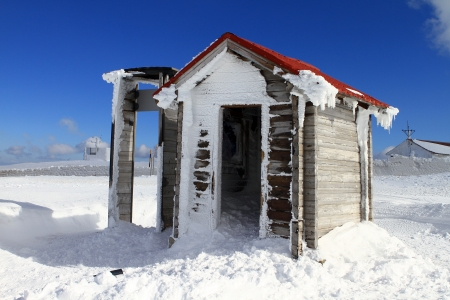 house in the snow mountain