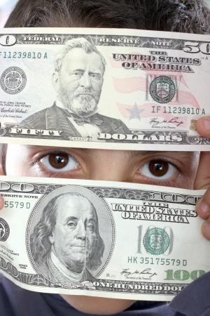 boy with dolar bills, business studio photo