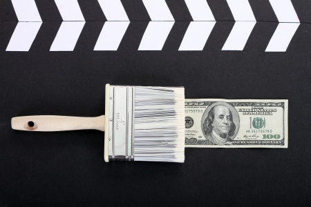 brush draws a dollar banknote, business photo