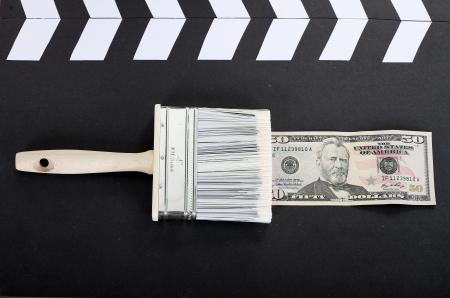 whitewash: brush draws a dollar banknote, business photo