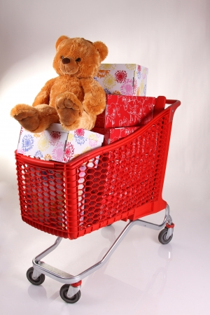 Shopping cart with lots of presents isolated on white background