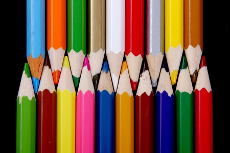 Assortment of coloured pencils with shadow on whiteblack background Stock Photo