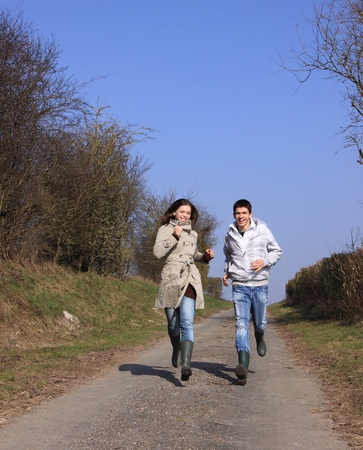 ballad: Couple of young people walking in the campaign in spring