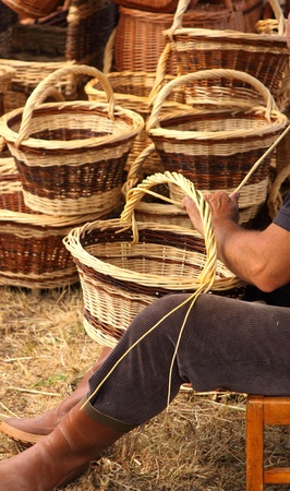 craft work: Details of the manufacturing of wicker baskets by a man Stock Photo