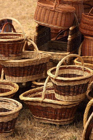 Details of the manufacturing of wicker baskets by a man photo