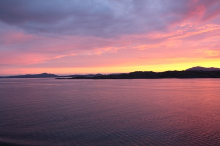 sunset view from a boat off the coast of norway
