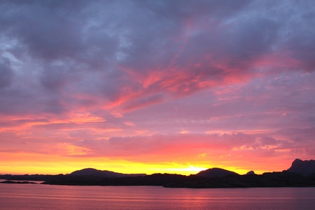 sunset view from a boat off the coast of norway Stock Photo - 10088101