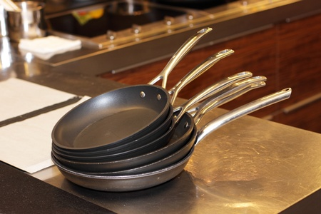 set of frying pans in the kitchen of a great leader