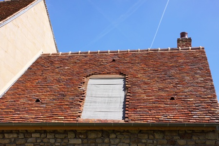 renovation of a tiled roof of an old house photo