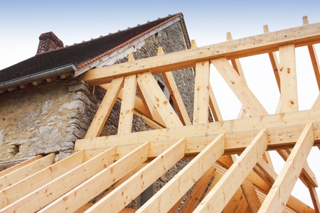 construction of the wooden frame of a roof photo