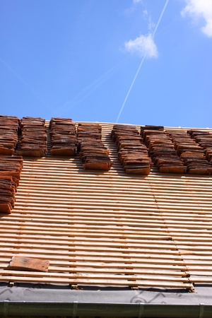 renovation of a tiled roof of an old house Stock Photo - 11017186