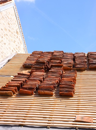 renovation of a tiled roof of an old house Stock Photo - 11170199