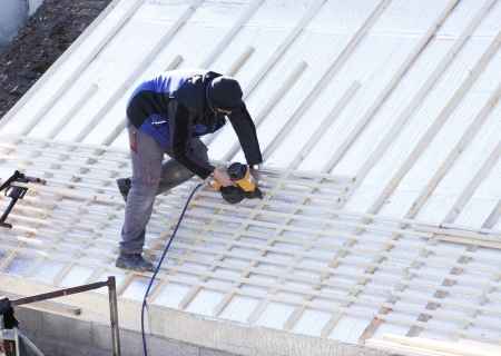 roofer working on a new roof in wood photo
