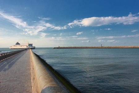 ferry boat entering in the channel of the port of Calais Standard-Bild
