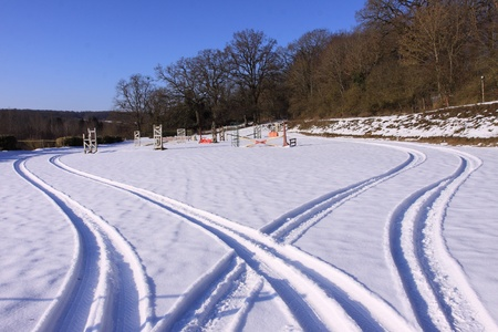 tire tracks in the snow in winter photo