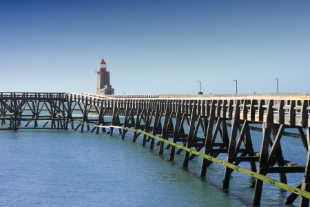wooden pier and  lighthouse of the port of f�camps in normandy france photo
