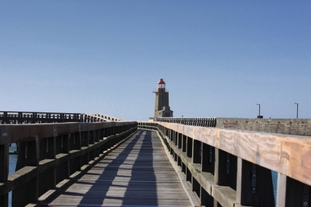starboard: wooden pier and  lighthouse of the port of f�camps in normandy france