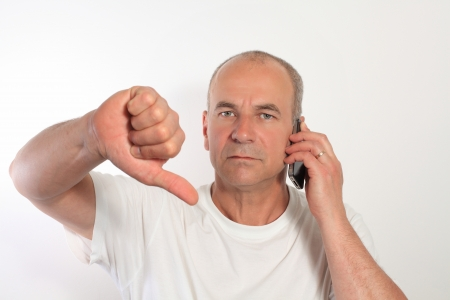 man of fifty with a mobile phone Stock Photo - 14360700