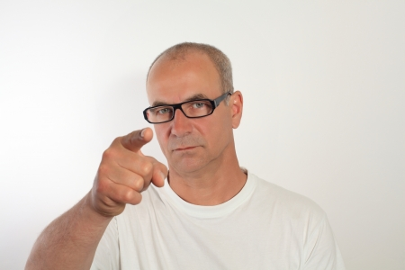 man of fifty with glasses shows the fingers Stock Photo - 14360699