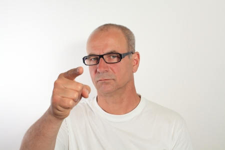 man of fifty with glasses shows the fingers Stock Photo - 14360698