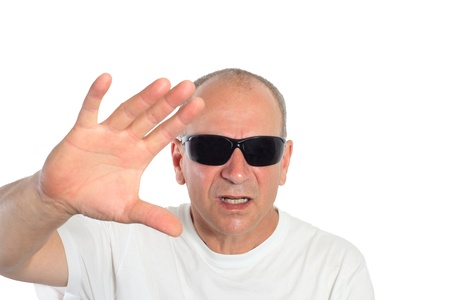 man with sunglasses making a sign Stock Photo - 15892101