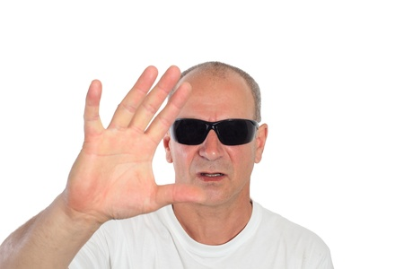 man with sunglasses making a sign photo