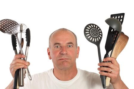 man lost with kitchen utensils photo