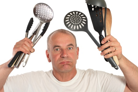 man lost with kitchen utensils photo
