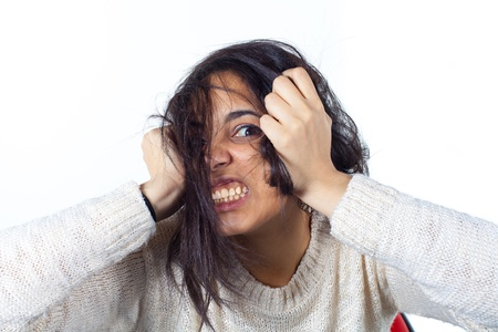 hysterics: Hysterical woman expression with her hands on the head on a white isolated background Stock Photo