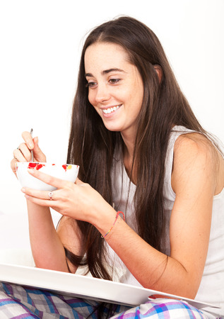 Woman drinking bowl at breakfast