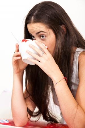 breakfeast: Woman drinking bowl at breakfast