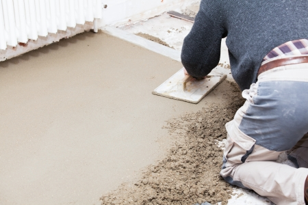 mason smooth the cement screed with trowel Stock Photo