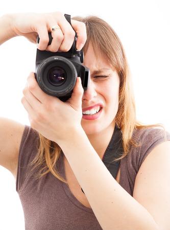 young woman using a camera to take photo  photo