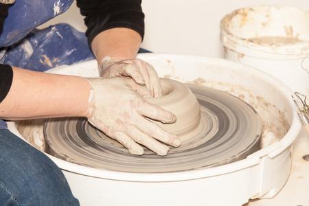 potters wheel: Female Potter creating a earthen jar on a Potters wheel