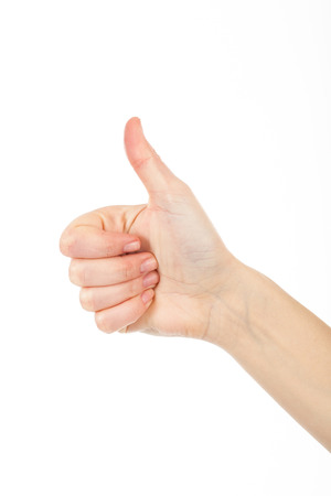 thumbup: Woman giving thumb-up for showing success. Womans right hand is nice idea.