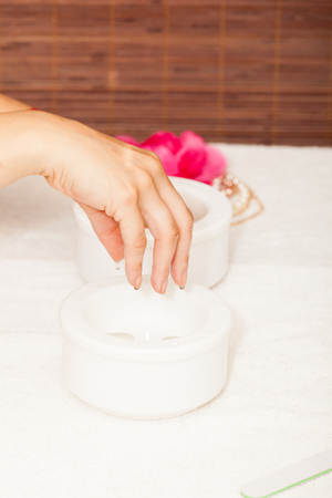 nails: Preparing a womans hands for a manicure