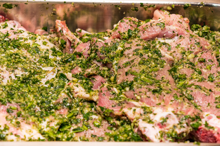 raw meats marinated in garlic olive oil parsley salt pepper