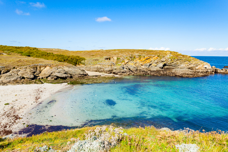 landscape beach rocks cliffs shores at Belle Ile en Mer at the point of foals in Morbihan 免版税图像