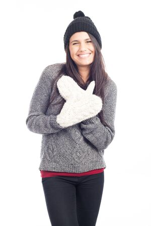 pretty brunette woman with a woolen hat a sweater and gloves smiling and cheerful Stock Photo