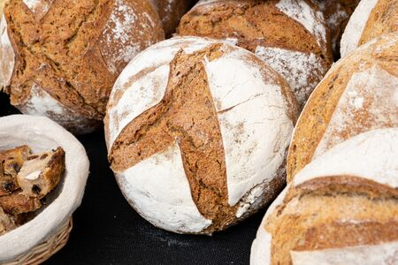 Organic country breads made with sourdough with different cereals and cooked over a wood fire in France