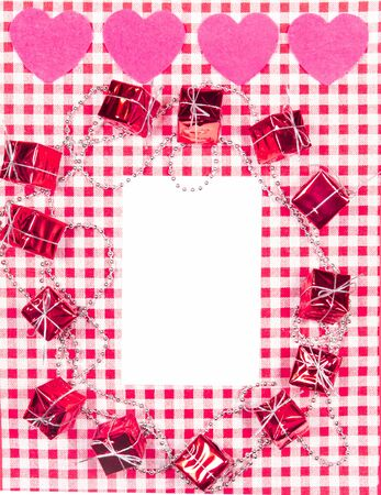 background with red and white Vichy fabric for Valentine's day with pink hearts, small gifts, garlands of small pearls and a white card to put the text. valentines day concept Stock Photo