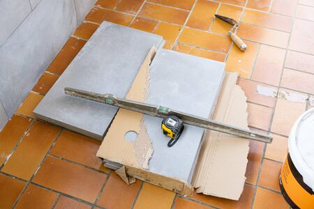 ceramic tile installation site with its tools