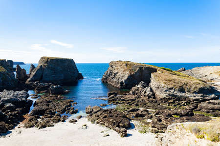landscape beach rocks cliffs shores at Belle Ile en Mer at the point of foals in Morbihan