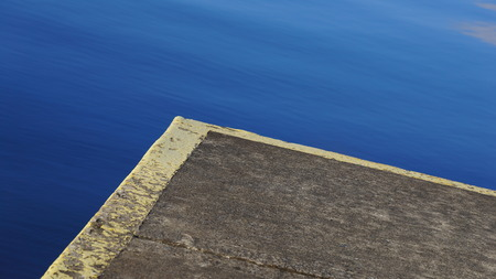 Abstract shot of the Concrete corner edge of a Pier 스톡 콘텐츠