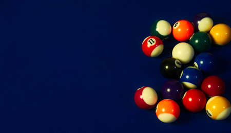 Sequence of black pool ball direct to the rest of the balls of the pool table, including the white one