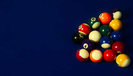 Billiard black ball hitting a group of colored balls 写真素材