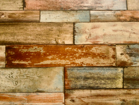 Background of colored wood planks, in different sizes, worn aspect, horizontal view Фото со стока