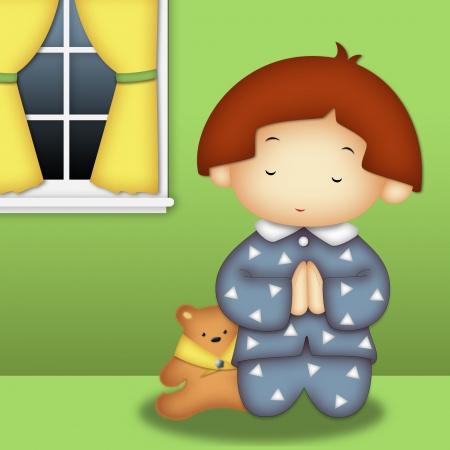 Praying boy wearing blue pajamas praying in his room Standard-Bild